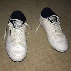 White Reebok Classic athletic shoes.